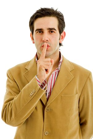 young man showing silence gesture with his finger in the mouth Stock Photo - 5917596