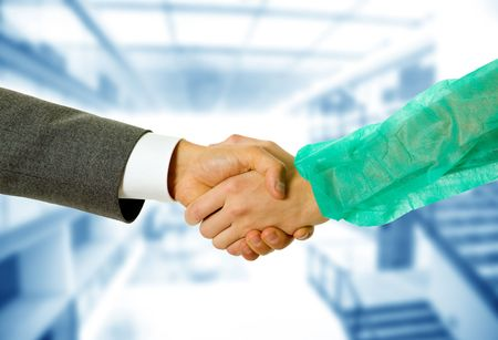 deal making: Business men and doctor hand shake, close up