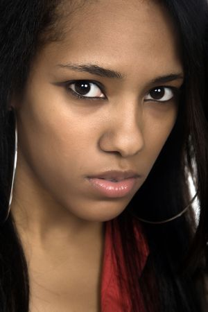 bronzed: young beautiful woman closeup portrait, studio shot Stock Photo