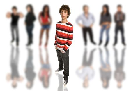 young casual boy full body, among some out of focus people photo
