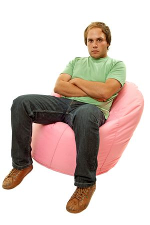 young casual man seated in a small sofa Stock Photo - 6452498