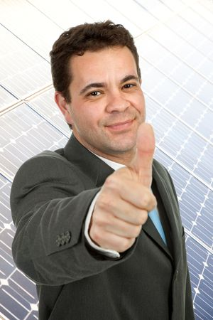 bilding: business man going thumb up with a office bilding behind Stock Photo