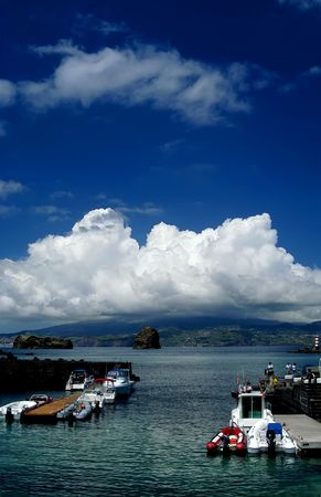 madalena: port of Madalena in Pico island, view to Faial island, Azores, Portugal