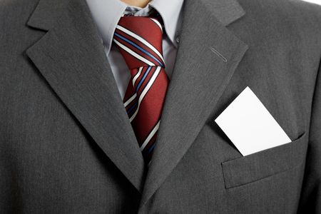 suit coat: businessman with a blank business card in his pocket