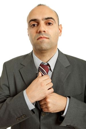 business man adjusting his tie isolated on white  photo
