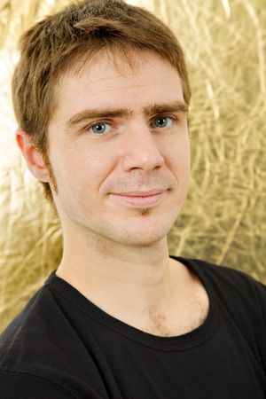 young casual man against a golden background photo