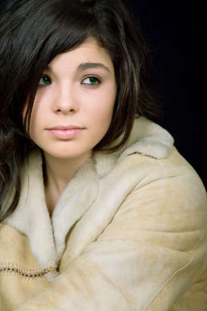 young beautiful brunette portrait against black background photo