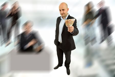 young business man with money, full length picture photo