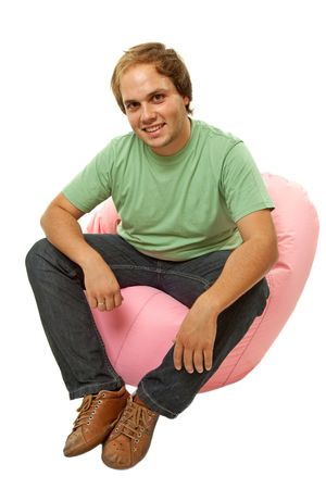young casual man seated in a small sofa Stock Photo - 7108919