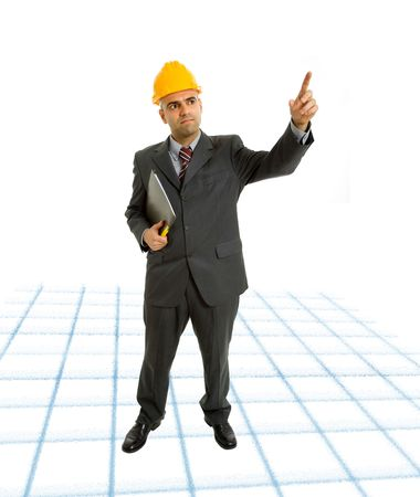 An engineer with yellow hat pointing up photo