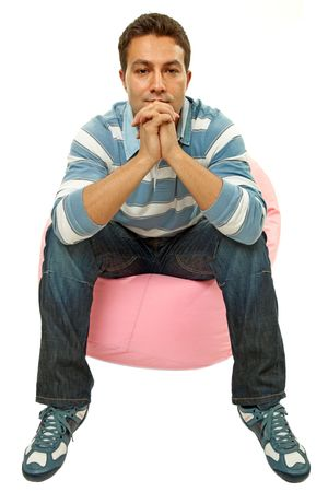 young casual man seated in a small sofa Stock Photo - 7366109
