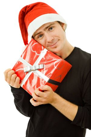 young man with santa hat holding a gift, isolated photo