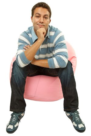 young casual man seated in a small sofa Stock Photo - 7378153