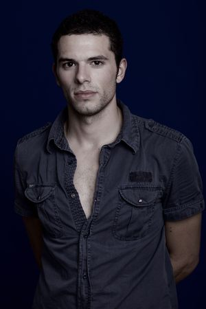 an casual young man portrait over a blue background