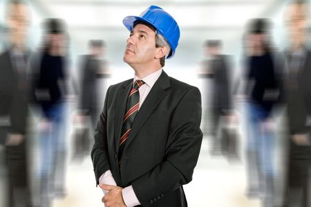 Mature engineer with blue hat looking up photo