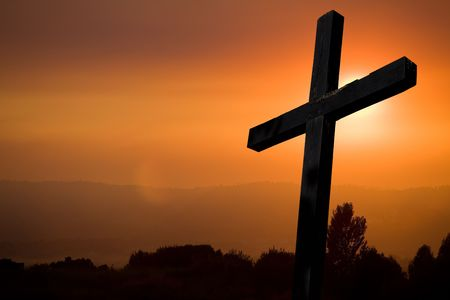 cross silhouette with the sunset as background Stock Photo - 7926638