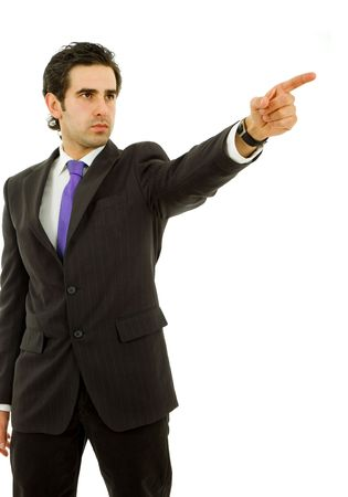 young business man in a suit pointing with his finger photo