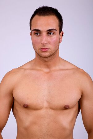 young sensual man on a grey background Stock Photo - 8037389