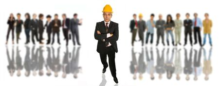 mature business man in front of a group of people photo