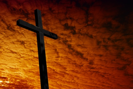 almighty: cross silhouette with the sunset as background