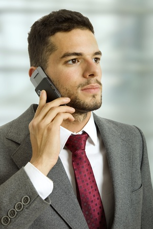 young business man on the phone, isolated photo