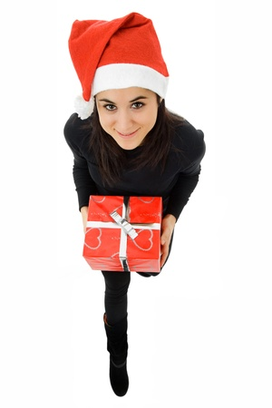 beautiful young girl holding a christmas gift, isolated photo