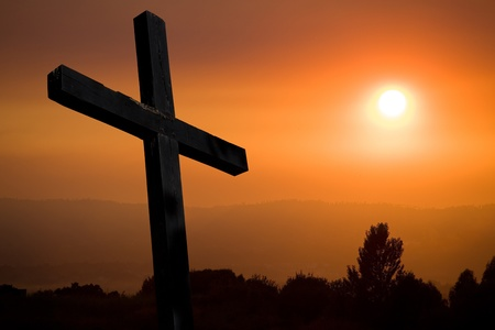 cross silhouette with the sunset as background Stock Photo - 8437817