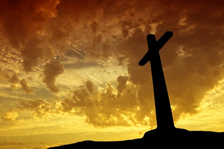cross silhouette with the sunset as background Stock Photo - 8474405