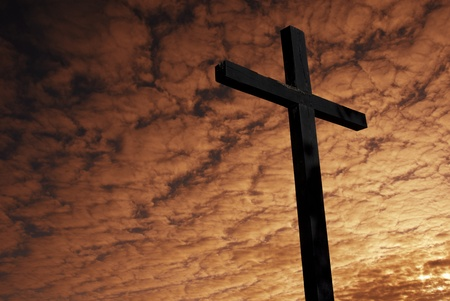 cross silhouette with the sunset as background Stock Photo - 8509538