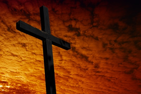 cross silhouette with the sunset as background Stock Photo - 8619226