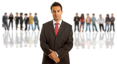 serene people: Young business man portrait with some people on the back Stock Photo