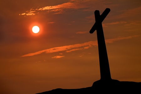 cross silhouette with the sunset as background photo