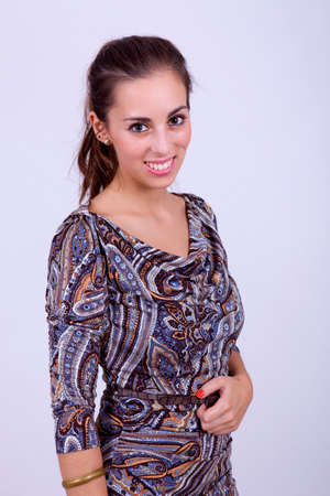 young happy beautiful woman on a grey background photo