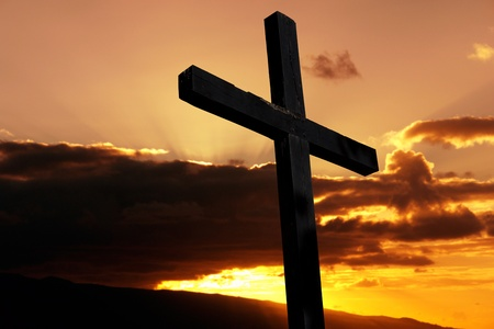 cross silhouette with the sunset as background Stock Photo - 8851464