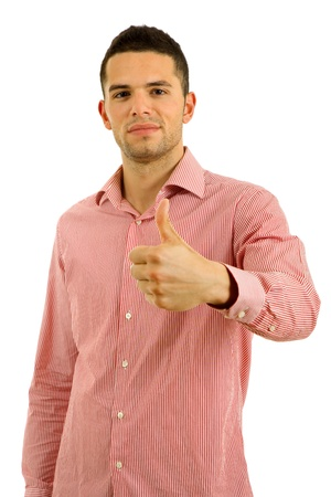 young casual man going thumb up in a white background Stock Photo - 8851651