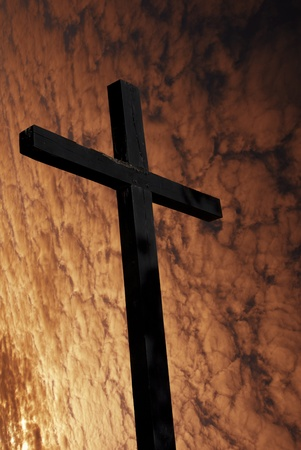 cross silhouette with the sunset as background Stock Photo - 8851719