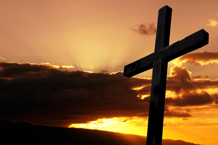 cross silhouette with the sunset as background Stock Photo - 8941185
