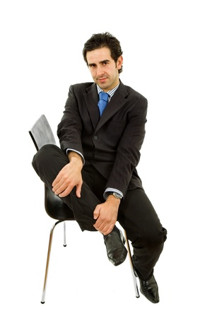 young businessman on a chair, isolated on white photo