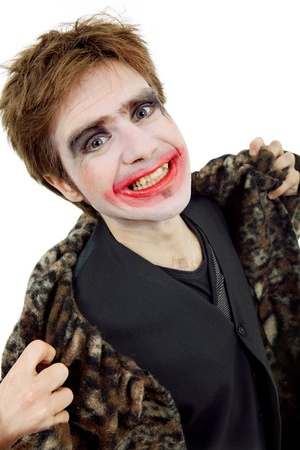 young man dressed as joker, isolated on white photo