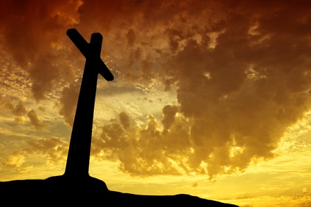 cross light: cross silhouette with the sunset as background