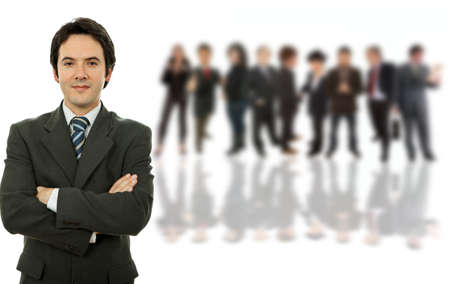young business man in front of a group of people photo