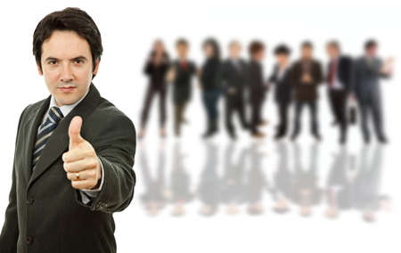 young business man going thumb up, with some people on the back photo