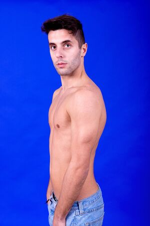 young casual topless man on a blue background Stock Photo - 9359052
