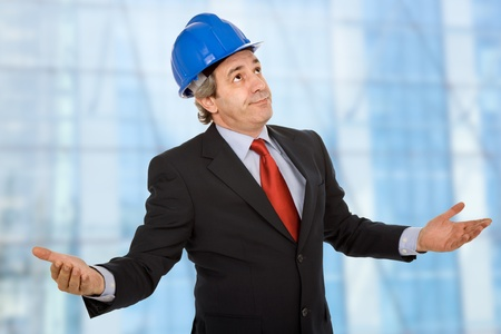 An engineer with blue hat with open arms photo