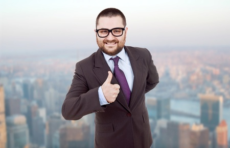 young silly business man going thumb up photo