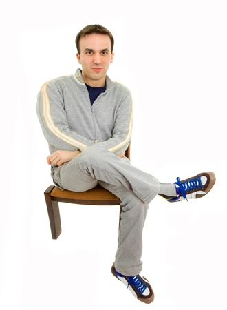 young casual man on a chair, isolated on white photo