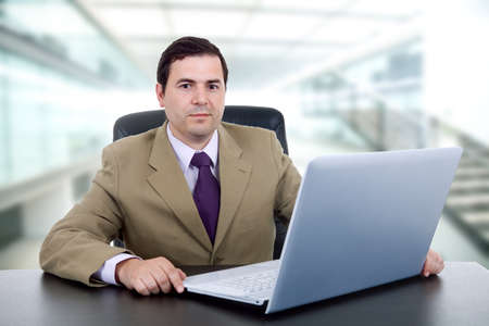 young business man working with is laptop photo