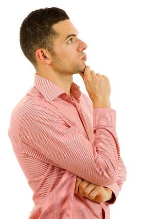 hombre pensando: estudio de la imagen de un hombre joven pensativo, aislado en blanco Foto de archivo