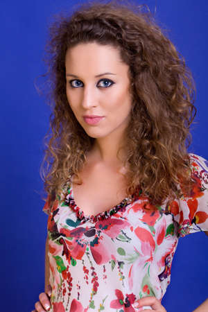 young beautiful woman, on a blue background photo