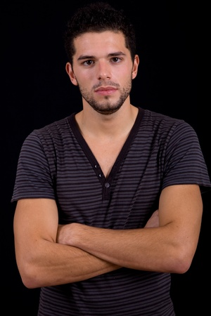 young man portrait, on a black background Stock Photo - 9621871